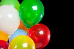 Balões Assorted em um fundo preto foto de stock royalty free