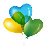 Balões coloridos, amarelo, verde e B da forma do coração Foto de Stock