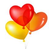 Balões coloridos, amarelo, vermelho e Ora da forma do coração Imagens de Stock