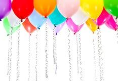 Balões coloridos com as flâmulas na festa de anos Fotografia de Stock