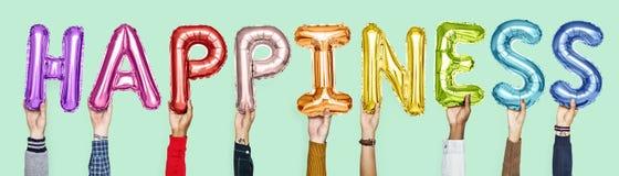 Balões coloridos do alfabeto que formam a felicidade da palavra fotos de stock royalty free