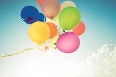 Balões coloridos feitos com um efeito retro do filtro do instagram imagem de stock royalty free