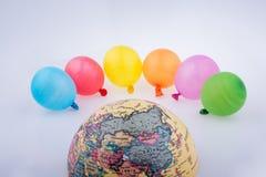 Balões da cor e a metade de um globo Imagem de Stock Royalty Free