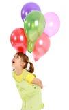 Balões da terra arrendada da menina imagem de stock royalty free