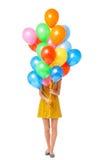 Balões da terra arrendada da mulher Imagens de Stock Royalty Free