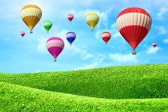 Balões de ar quente que flutuam sobre o campo verde Foto de Stock Royalty Free