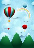 Balões de ar quente sobre a montanha Fotografia de Stock Royalty Free