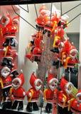 Balões de Santa Claus na janela de loja Fotos de Stock