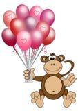 Balões do coração da terra arrendada do macaco Imagens de Stock
