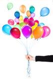 Balões do voo com mão do homem de negócios Imagem de Stock