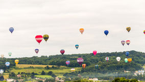 Balões que descolam em Bristol Balloon Fiesta K 2016 Fotos de Stock Royalty Free