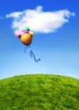Balões que flutuam no céu azul Imagens de Stock Royalty Free