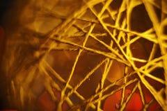 Bal van de close-up de donkere gele streng Stock Foto