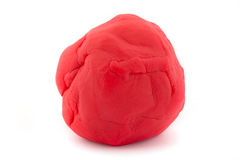 Bal van rode plasticine op wit Stock Afbeeldingen
