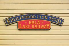 Bala Lake Railway Sign. Station sign at the Bala Lake Railway or Rheilffordd Llyn Tegid in Welsh at Llanuwchllyn station a narrow gauge steam train heritage line Royalty Free Stock Images