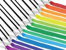 Balais et impressions colorées Photographie stock