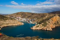 Balaklava bay in Crimea, mountain cliffs and sea port with ships. Beautiful nature panorama landscape, town among hills. And black sea coast. Summer travel royalty free stock photos