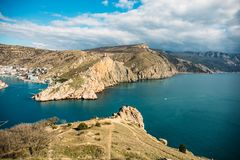 Balaklava bay in Crimea, mountain cliffs and sea port with ships. Beautiful nature panorama landscape, town among hills. And black sea coast. Summer travel royalty free stock image