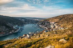 Balaklava bay, Crimea. Panoramic view from hill with fortress Cembalo to small town with harbour and yachts with boats. Among mountains stock image