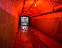 Balaklava, Crimea - September 2016: Red light corridor inside the Naval museum submarine complex. Crimea, Russia Royalty Free Stock Photography