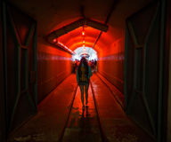 Balaklava, Crimea - September 2016: Red light corridor inside the Naval museum submarine complex. Crimea, Russia Royalty Free Stock Photo