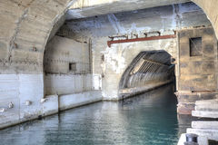 Balaklava. Former secret repair dock of submarine boats. RUSSIA, CRIMEA, BALAKLAVA - May 11.2014: Tunnel on territory of former military dock on repair of atomic stock photography