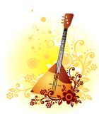 Balalaika. On a white background with a yellow and brown pattern with circles Royalty Free Stock Images