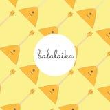 Balalaika piega dello strumento della corda su un fondo colorato Immagini Stock Libere da Diritti
