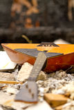 Balalaika on the ruins of a destroyed house Stock Image