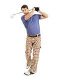 Balançando um clube de golfe Fotografia de Stock Royalty Free