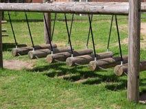 Balanços de madeira em um campo de jogos Fotos de Stock Royalty Free