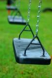 Balanços no parque Fotos de Stock Royalty Free