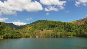 Balanan lake view time lapse. A time lapse video showing the idyllic beauty of the mountain lake Balanan in Negros Oriental, Philippines.  Small waves can be stock video