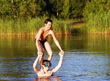 The Balance. The boy trying to keep a balance standing on his friend shoulders Stock Images