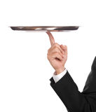 Balance. Waiter with empty tray, balancing on one finger Stock Images