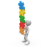Balance. 3d person trying to balance a pile of puzzle pieces Royalty Free Stock Images