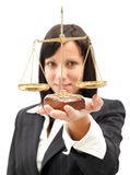Balance. Attractive woman in elegant suit holding scales of balance stock photography