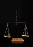 Balance. A pharmacist balance on a black background Stock Photography