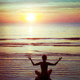 Balance. And harmony, yoga on the beach, silhouette stock photo