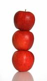 Balance. Three red apples one on another Royalty Free Stock Image