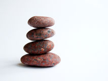 Balance. Four granite stones on white Royalty Free Stock Image