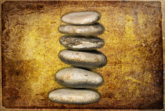 Balance. Six tiled pebbles in balance on a textured background Royalty Free Stock Image