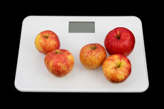 Balance with apples 2. Balance with five apples and a black background Royalty Free Stock Images