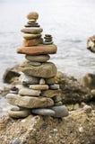 Balance. D stack of stones on the seashore stock photos