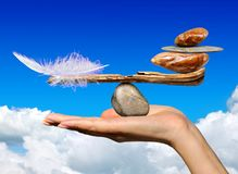 The balance of the bird`s feather and stones Royalty Free Stock Images