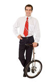 Balance in business - man with monocycle Royalty Free Stock Photos