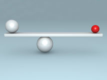 Balance concept with two red and white balls. On scales Stock Image