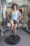 Balance and core exercise. Woman on a balance trainer exercising in the gym Royalty Free Stock Images