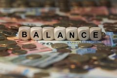 Balance - cube with letters, money sector terms - sign with wooden cubes Stock Image