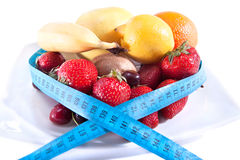 Balance diet with less calories. Fresh fruits royalty free stock photography